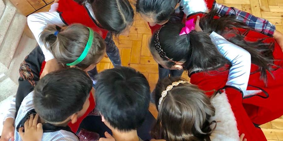 Children in a huddle