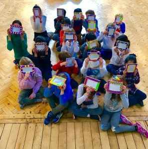 Children displaying their artwork